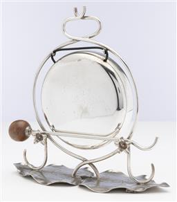 Sale 9245R - Lot 70 - An antique silverplate dinner gong C: 1900, the circular gong raised on a support with 2 flowers to hold the striker, raised on a ba...