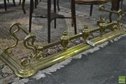 Sale 8345 - Lot 1021 - Edwardian brass fire fender, with large turned urn supports