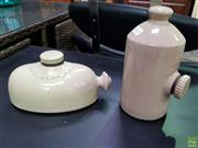 Sale 8629 - Lot 1024 - Set of Two Ceramic Vessels