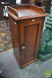 Sale 8335 - Lot 1041 - 19th Century Cedar Bedside Cabinet, with gallery back & single panel door