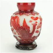 Sale 8393B - Lot 21 - Peking Glass Red Overlay Vase on a Carved Timber Stand