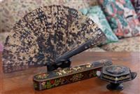 Sale 8963H - Lot 56 - An Indo-Persian painted lacquer pen case with a Russian painted floral form trinket box (signed) and a pierced tortoiseshell fan. Pe...