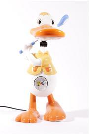 Sale 9015 - Lot 48 - A Golfer Duck Lamp (H: 46cm)