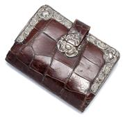 Sale 9037 - Lot 362 - AN ANTIQUE CROCODILE AND STERLING SILVER PURSE;  purse with silver scroll fittings and trim, (some dents), with Birmingham import ma...