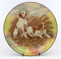 Sale 9245R - Lot 72 - A Royal Doulton cabinet plate decorated with 2 Brittany Spaniels, C: 1930, D: 26cm