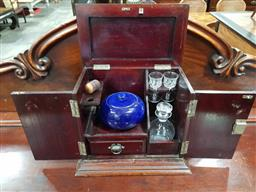 Sale 9097 - Lot 1034 - Late Victorian/ Edwardian Walnut Smokers Companion, with two panel doors and fitted interior, including tobacco bow land pipe (key...