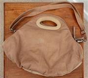 Sale 9066H - Lot 132 - A Manzoni hobo bag in light browns with straps