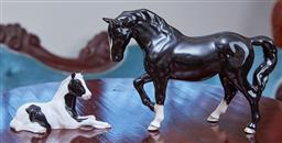 Sale 9103M - Lot 465 - A Beswick black glazed jogging mare figure, Length 23cm together with a black and white glazed foal, Length 13cm