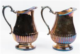 Sale 9130S - Lot 41 - A pair of Whitehill silver plated water jugs. Height 23cm