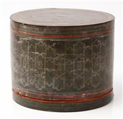 Sale 9048A - Lot 40 - A Burmese cylindrical lacquered betel nut box in black and red with repeating geometric body, Height 17cm, diameter 21cm