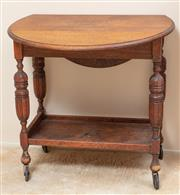 Sale 9071H - Lot 45 - An oak fall front tea table on castors, Height 73cm x Width 75cm, extended Length 90cm