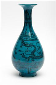 Sale 8697A - Lot 78 - A Chinese pear shaped vase decorated with cloud form cartouches and flying dragons over a turquoise ground, height 26.5cm