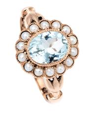 Sale 9066 - Lot 391 - A GEORGIAN STYLE AQUAMARINE AND PEARL CLUSTER RING; millegrain set with an approx. 1.50ct oval cut aquamarine to surround of seed pe...