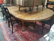 Sale 8680 - Lot 1060 - Oak Extension Dining Table on Stretcher Base