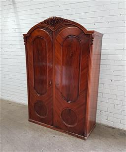 Sale 9142 - Lot 1003 - 19th Century Continental Walnut Armoire, with carved crest & two oval panel doors - some faults, key in office (h:185 x w:125 x d:50cm)