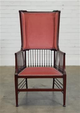 Sale 9196 - Lot 1033 - Unusual Arts & Crafts Mahogany Wingback Armchair, upholstered in pink fabric, with delicate spindle gallery, on tapering legs joined...