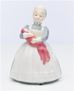 Sale 9245R - Lot 79 - An English Royal Doulton bone china figure, The Rag Doll, designed by Peggy Davies, HN 2142, Ht: 12cm