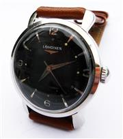 Sale 8387A - Lot 7 - A vintage mens Longines black dial wristwatch in stainless steel case. Automatic circa 1950s. 19AS movement. Running well. 33 mm.