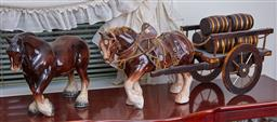 Sale 9103M - Lot 470 - A large ceramic horse with saddle and a carriage, repaired leg, total Length 68cm, together with another