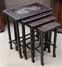 Sale 8963H - Lot 57 - A Japanese dark lacquer nest of four tables with dragons, Height 64cm x Length 60cm x Depth 56cm