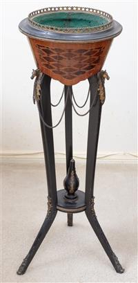 Sale 8963H - Lot 74 - A Napoleon III ebonised and parquetry raised jardinière with gilt brass mounts of horses heads, Height 93cm