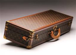 Sale 9122 - Lot 100 - Louis Vuitton Bespoke Full Size Violin Case. Provenance: Richard Tognetti. (H:15cm L:80cm D:27cm)