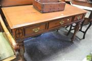 Sale 8390 - Lot 1030 - Indian Padouk & Rosewood Side Table in the Victorian Style with shaped back and three drawers on turned faceted legs.