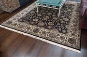 Sale 8782A - Lot 116 - Large Jaipur  woollen carpet with floral design on a black ground. 250 x 310