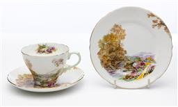 Sale 9245R - Lot 85 - An English Shelley bone china cup, saucer and plate in the Heather pattern, C: 1930