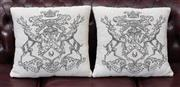 Sale 8782A - Lot 107 - A Pair of Arabella scatter cushions with crest design. 40cm