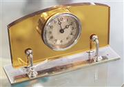 Sale 8319 - Lot 318 - Small art deco alarm bedside clock with amber glass and silver plated stand