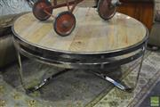 Sale 8361 - Lot 1052 - Round Stainless Steel Coffee Table