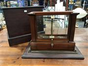 Sale 8893 - Lot 1068 - Good Beckers & Sons Rotterdam Scientific Scales, in mahogany glass case, itself with a further travelling timber case
