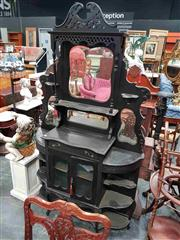 Sale 8925 - Lot 1095 - An edwardian ebonised display cabinet with mirrored overshelf