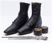 Sale 9080W - Lot 79 - A pair of Victorian leather ladies button up boots together with two tins of polish and two boot hooks, one hallmarked.