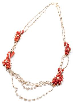 Sale 9160 - Lot 361 - A VINTAGE ITALIAN CORAL AND PEARL NECKLACE; 4 carved floral coral plaques set with seed pearls to 16ct gold backs (36-46cm) joined b...