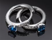 Sale 8904H - Lot 78 - A PAIR OF SAPPHIRE AND DIAMOND HOOP EARRINGS; each a 13.5mm wide hinged hoop set with a blue oval sapphire and 9 round brilliant cut...