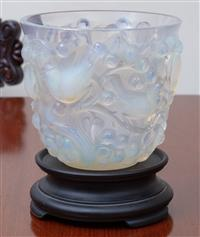 Sale 8963H - Lot 58 - A Rene Lalique Avallon opalescent glass vase mottled with birds amongst cherry branches, wheel engraved mark to footrim, together...