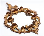 Sale 8873A - Lot 83 - A Rococco style carved and gilt display mirror with ten small shelves