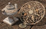 Sale 8902H - Lot 4 - A cast hose wheel of intricate detail together with a campagna form urn on stepped base and a metal candlestick. Diameter or wheel 41cm