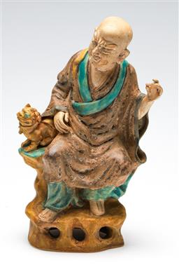 Sale 9246 - Lot 29 - A Chinese potted figure of a man and foo dog (H:25cm)