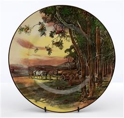 Sale 9245R - Lot 90 - A Royal Doulton cabinet plate decorated with a scene of bush logging C: 1936, D: 26cm
