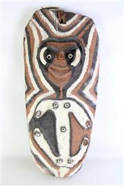 Sale 8935 - Lot 25 - A Carved Cultural Decorative Mask with Boar Tusk Decoration, Possibly Sepik River (H 80cm W 40cm)