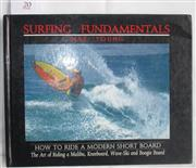 Sale 8431B - Lot 20 - Surfing Fundamentals by Nat Young, Palm Beach Press 1985. Inscribed and signed by Nat Young, November 1986. Hardback, 128 pages