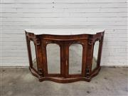 Sale 9068 - Lot 1090 - Victorian Burr Walnut Credenza, with white serpentine shaped marble top, above four arched mirror panel doors, flanked by brackets (...