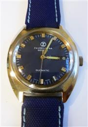 Sale 8387A - Lot 13 - A Favre - Leuba Genève vintage wristwatch circa 1970s blue dial automatic with stitched blue fabric band. 36 mm. Running well.