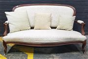 Sale 9031 - Lot 1067 - Late 19th Century French Carved Rosewood Settee, upholstered in a cream scroll fabric & cabriole legs