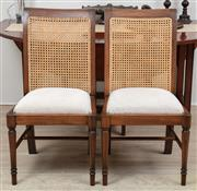 Sale 8902H - Lot 9 - A pair of Coco Republic cane back and linen upholstered dining chairs, Height of back 96cm