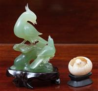 Sale 8963H - Lot 60 - A Chinese carved greenstone figure of birds and an ivory hatched chick, tallest 11cm