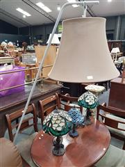Sale 8744 - Lot 1090 - A modern floor lamp with heavy base, angled arm and cloth shade